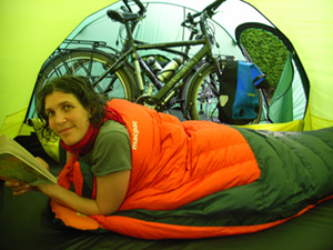 Krista Bernard of RideHimalaya sleeping in her new Macpac sleeping bag