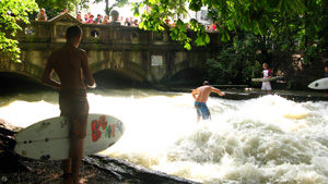 Photo: Surfing a wave on a river in the city of Munich, Germany